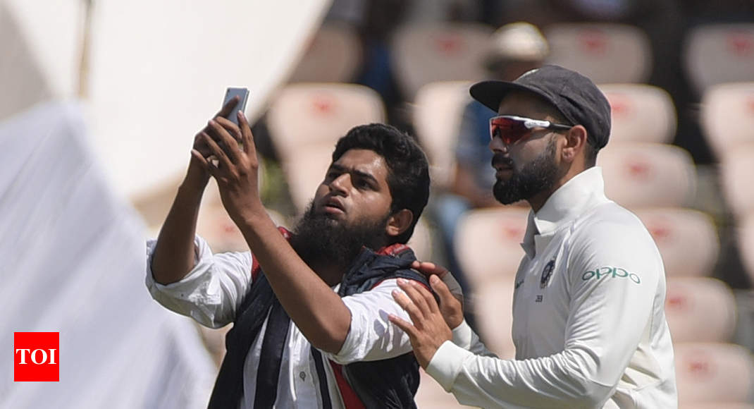 Selfie with Virat Kohli: Case filed against fan - Times of India