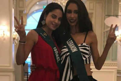 Beauty queen dethroned for clicking picture with Miss Earth Israel