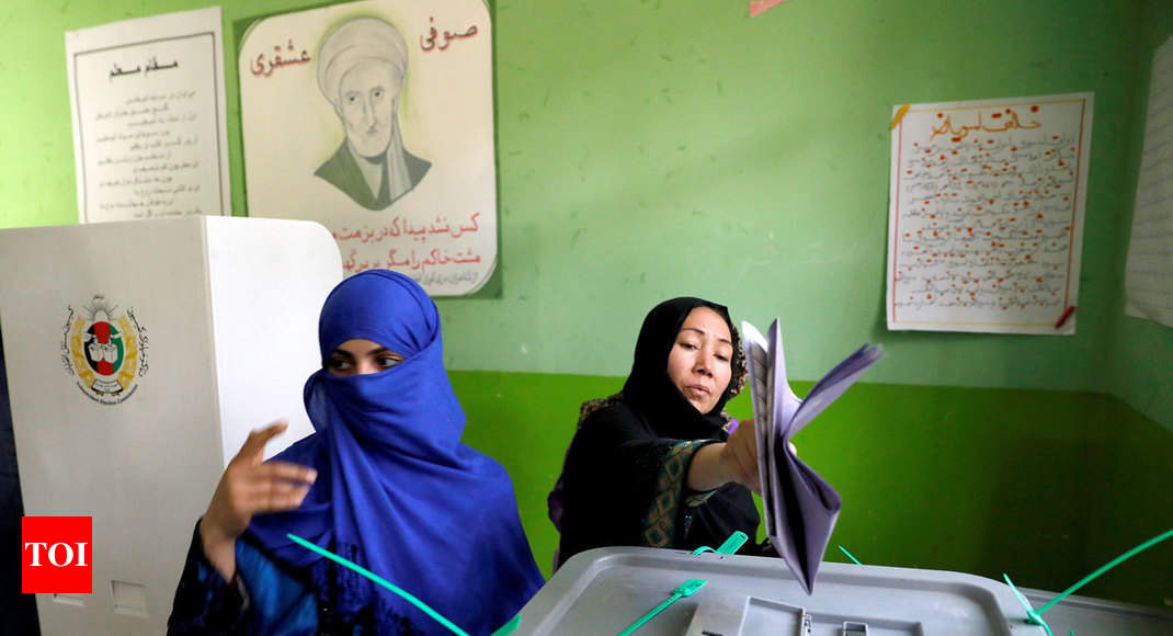 Afghans shut out by polling station chaos return to vote - Times of India