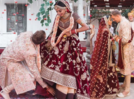 A progressive wedding: Husband touches wife's feet to show mutual respect