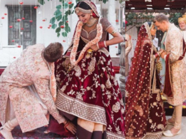 This groom set an example by touching the bride's feet