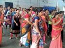 Ladies shake their legs to traditional garba