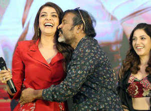 Kajal Aggarwal forcibly kissed by cinematographer Chota K Naidu at Kavacham teaser launch