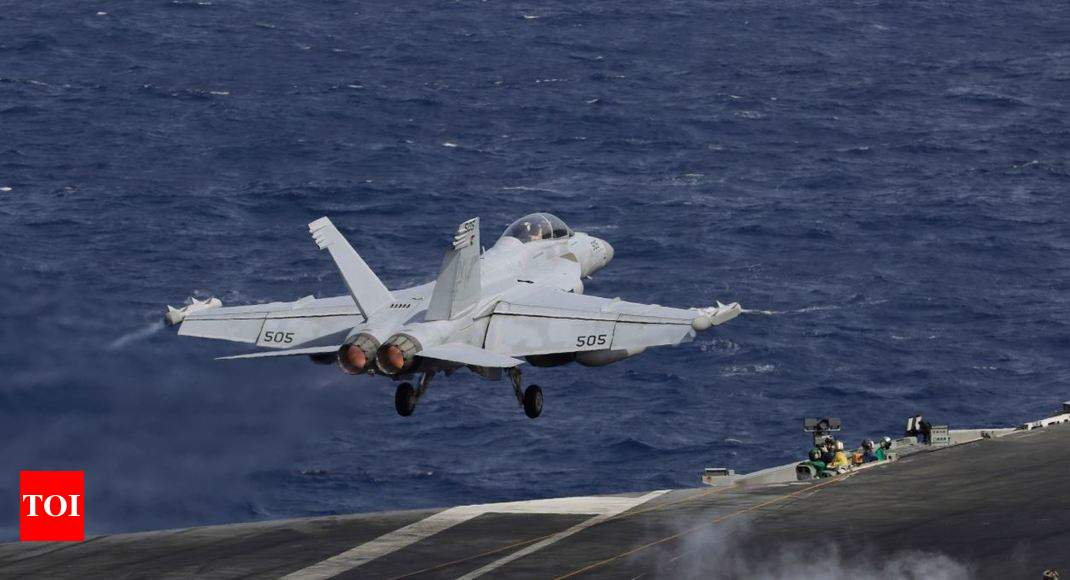 US carrier in Hong Kong after bombers fly over South China Sea
