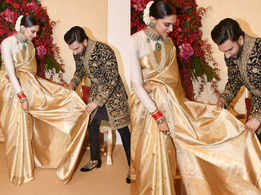 Ranveer fixes Deepika's sari at their reception!
