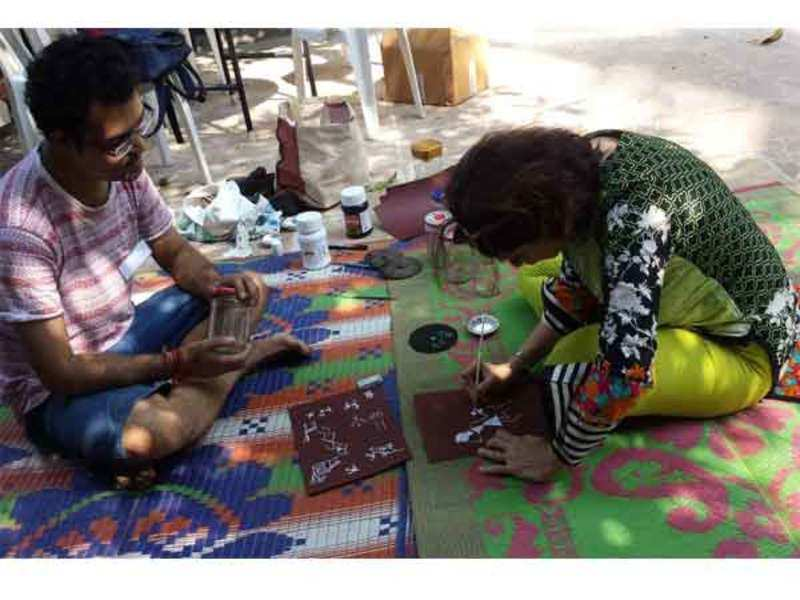 During the Warli art painting session at the Adivasi cultural event at Bandra