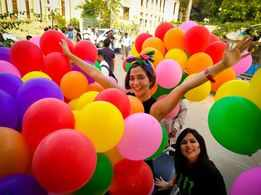 Family members of LGBTQIA+ community walk with pride