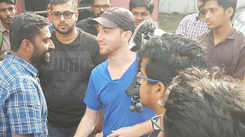 Blogger Drew Binsky interacts with Kochi youth