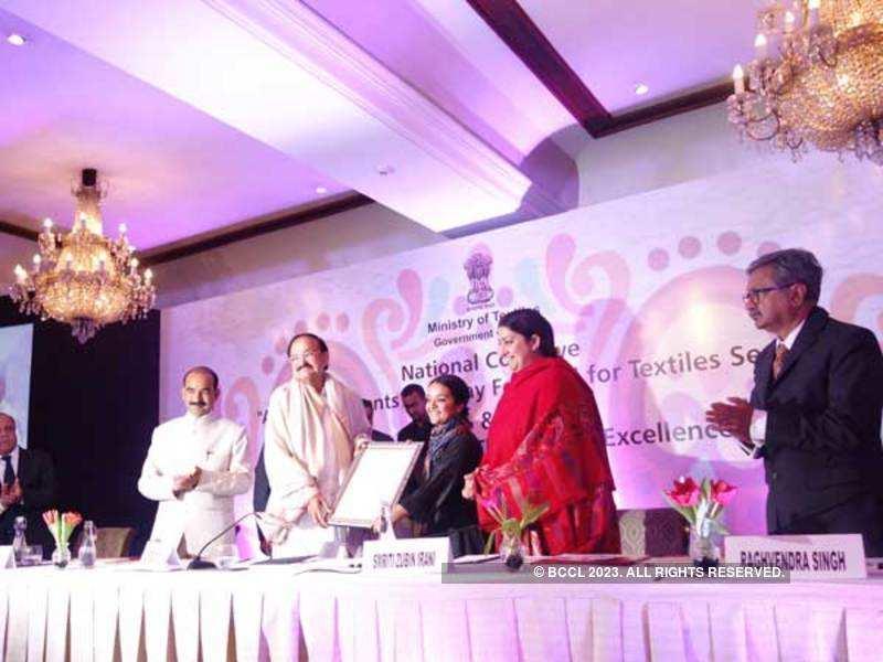 (L to R) Minister of State for Textiles Ajay Tamta, Vice President M Venkaiah Naidu,  designer Aneeth Arora, Union Textiles Minister Smriti Irani and Textiles Secretary Raghvendra Singh