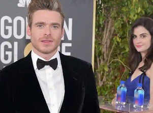 """Photobombing """"water girl"""" from Golden Globes red carpet becomes latest social media star"""