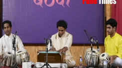 Students playing harmonium at event happend in pune