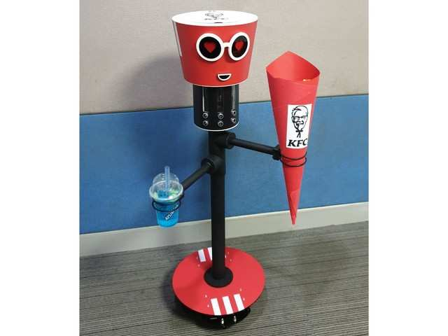 This KFC robot will carry chicken bucket, drink and walk around with you