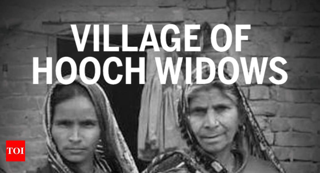 In 'village of hooch widows', stench of alcohol, fear of mafia