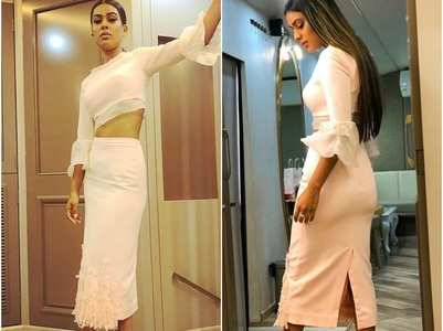 Nia Sharma stuns in a pink pencil skirt