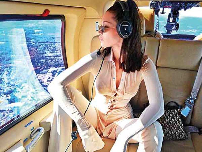 Bella Hadid strikes a chic pose with it on an airplane (Pic courtesy: Instagram)