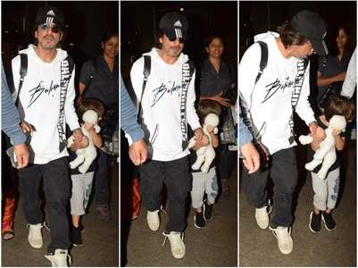 SRK's son AbRam tries to dodge shutterbugs