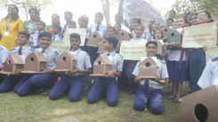 School children create Sparrow Houses and fix them on trees at Tikujiniwadi Yeoor Gate Forest area