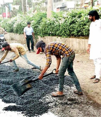 Residents repair a stretch in Wagholi