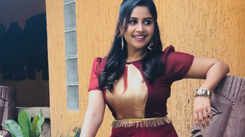 Anushree carries off gowns in style