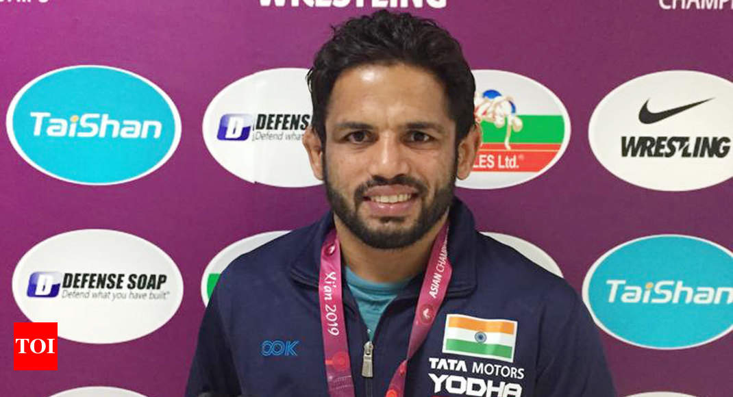 Amit Dhankar settles for silver, Rahul Aware for bronze in Asian Wrestling Championships - Times of India