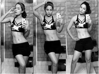 Hina flaunts washboard abs in gym wear