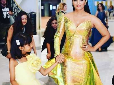 Ash looks like a gold fish as she poses with Aaradhya