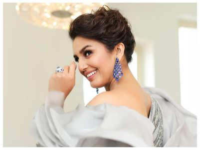 Huma Qureshi stuns in a grey metallic gown