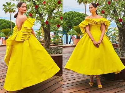 Sonam dazzles in a bright yellow gown on Day2