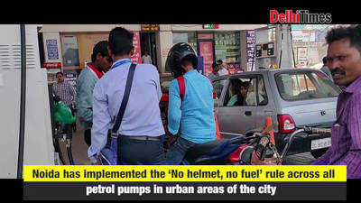 Day 1: Jugaad galore as 'no helmet, no fuel' rule takes Noida commuters by  surprise