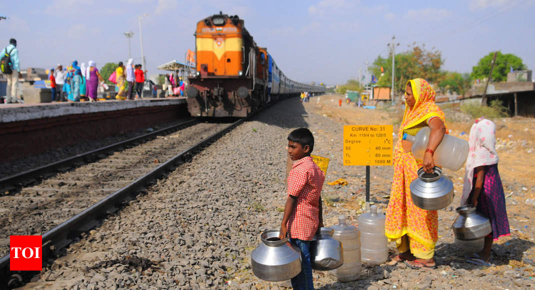10-year old boy's 14-km train journey to get two cans of water - Times of India