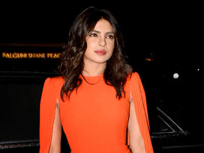Wear hot tangerine shade like Priyanka Chopra