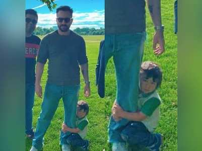 Pic: Taimur clings to his daddy Saif's leg