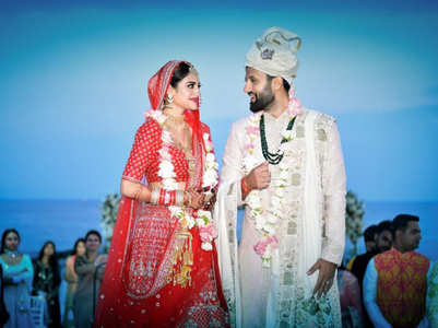 Nusrat wore the most gorgeous RED lehenga on her wedding