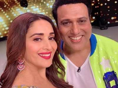 Madhuri strikes a smiling pose with Govinda