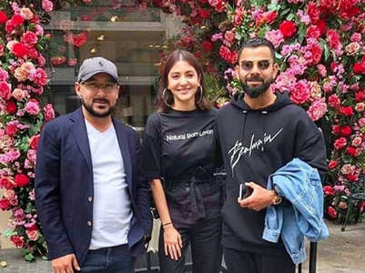 Photos: Anushka and Virat twin in black