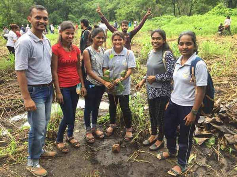Participants plant trees during the #pedlagao campaign at Aarey