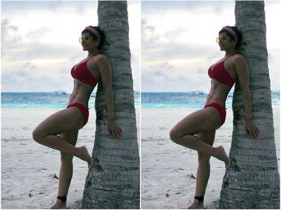 Mandira shares pic in a fiery red bikini