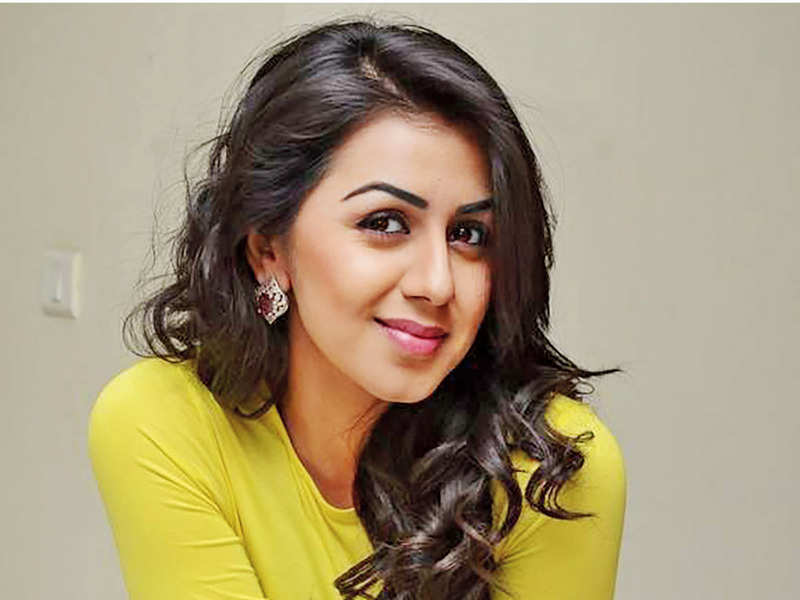 Nikki Galrani to go glam in Omar Lulu's Dhamaka