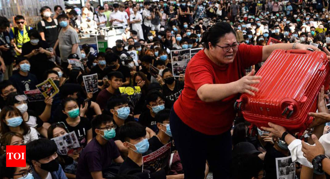 Hong Kong airport suspends check-in operations amid protests - Times of India