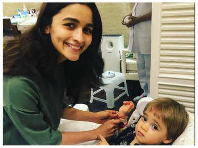 Alia Bhatt ties rakhi to KJo's son Yash