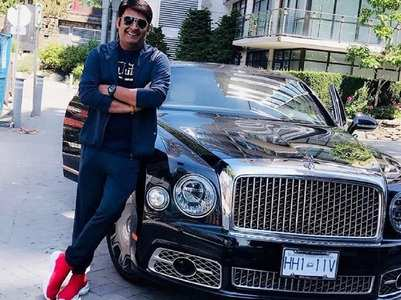 Kapil Sharma poses in style with a luxury car