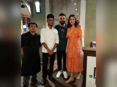 Anushka and Virat pose with chefs!