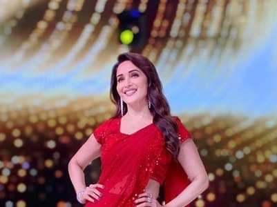No one wears red like Madhuri Dixit Nene