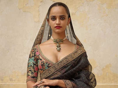 You can't miss to see Sabyasachi's black sari collection!