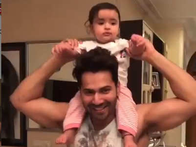 Varun gives a piggy back ride to his niece