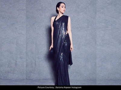 Karisma stuns in a sequined black saree