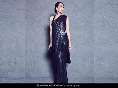 Karisma stuns in a sequined black saree