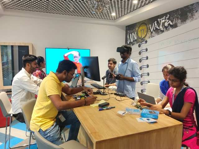 Engineers test an AR model in PayPal's Chennai Innovation Lab