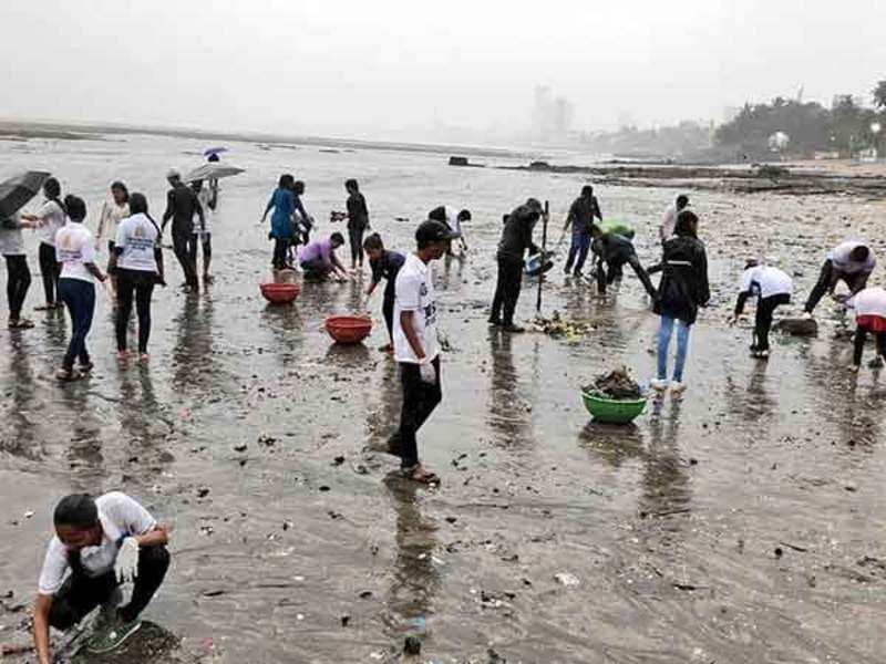 Beach warriors  during the first post-visarjan clean-up at Dadar Beach this morning