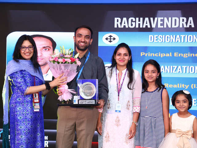 Every year, Intel India felicitates its new PEs, Senior PEs and Intel Fellow during its annual Innovation Day – part of an effort to encourage its technologists to stay focused on tech. This photo is from last year's event, when Raghavendra Bhat, a newly appointed principal engineer, along with his family, was felicitated by Intel India country head Nivruti Rai. Seven other PEs, senior PEs and the first Intel Fellow in India, Dheemanth Nagaraj, were also recognised at the event